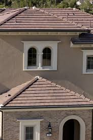 try a concrete roof tile color like eagle s caliente or kona red range to complement the arches stonework and stucco of your home s spanish influenced