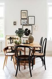 mismatched dining chairs in an eclectic dining room