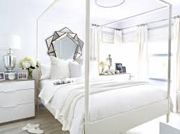 Beautiful All White Bedroom Ideas, Luxurious all white bed with upholstered  tufted headboard, white nightstands, white lamps, and creamy white bedding.