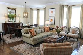 earth tone colors living room traditional with bay window area rug treatments rugs round wi