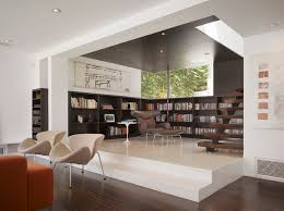 Inspiration for a small modern open concept dark wood floor living room  library remodel in Los