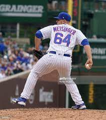 the Chicago Cubs throws a pitch against ...