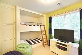 decoration dazzling bunk bed with desk underneath in kids traditional bedroom next to built closet
