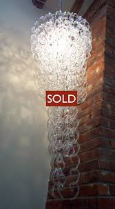 cur stock italian chandelier of clear glass hooks hung on circular stainless steel frame diameter 50cm length 130cm plus chain length to suit