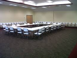 16 round tables 60 inch 5 feet across 29 inches tall each table seats 6 8 people 128 chairs projector with wall mounted retractable screen