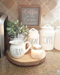 A white wall, a white shelf, white cups, and white art pieces. 20 Coffee Station Ideas For Your Home Decor Craftsonfire