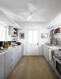 gray galley style kitchen with gray and white quartzite countertops
