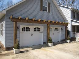 vinyl arbor over garage door