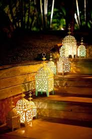 outdoor moroccan lighting. A Cute Set Of Simple Moroccan Lanterns Used Outdoors In Garden. #Moroccan #Lanterns. Www.mycraftwork.com/ Outdoor Lighting C