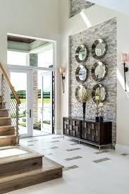 how to decorate a large wall trnsitionl wlls nd vaulted ceiling above stairs with fireplace how to decorate a large wall
