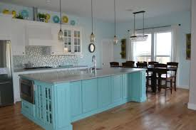 White Kitchen Cabinets With Teal Island Grey Quartz Countertops