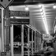 black and white wall art featuring pike place market post alley in seattle