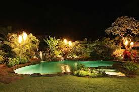 tiki lighting. Tiki Torches Combine With Uplighting To Set The Mood At This Honolulu Home.  Gas Tiki Lighting