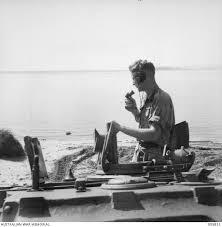 CAPE WOM, WEWAK AREA, NEW GUINEA. 1945-08-30. TROOPER E.M. LAWLER IN TURRET  OF A MATILDA TANK AT ... | Australian War Memorial