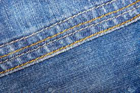 Blue Jeans With Yellow And Orange Stitches As A Backdrop Classical