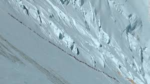 anshu jamsenpa first w to ascend mount everest twice in five mountaineer ralf dujmovits took this image of a long line of climbers heading up everest in
