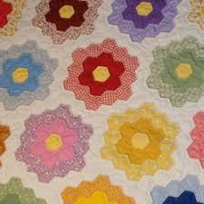 Manic Monday: Grandmother's Flower Garden Quilt   Craftster Blog & Grandmother's Flower Garden Quilt Adamdwight.com