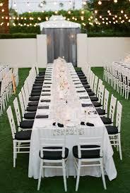 outdoor garden black and white elegant garden wedding long table reception lane dittoe photography
