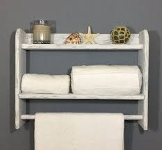 white bathroom shelf with towel bar