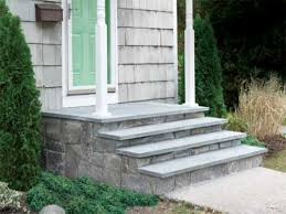 laying a stone patio diy stairs over concrete steps