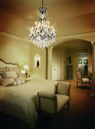 modern bedroom decoration with crystal chandelier and lighting also white bedding plus bedroom bench viewing