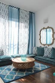 aqua curtains living room mediterranean with teal rectangular area rugs
