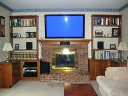 living room with tv over fireplace. Tv Above Fireplace Mounting A Over Install Pt 1 Stone Into Brick Living Room With