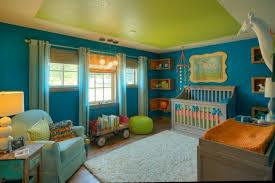 baby crib with blue ribbon cream rug blue painted wall green painted ceiling light blue curtains