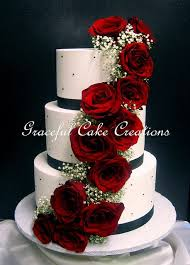 Elegant White Butter Cream Wedding Cake With Black Ribbon And Pearls