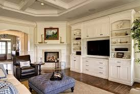 furniture placement around corner fireplace family room traditional with built in cabinetry rectangular area rugs