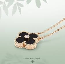 van cleef arpel limited edition onyx and pink gold vintage alhambra pendant a brilliant cut diamond embellishes the center of the renowned alhambra