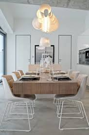 interior unique chandelier above tableware on wood table closed simple chair on floor for stunning interior foxy modern light fixtures