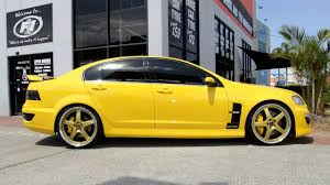 simmons wheels. holden e3 hsv gts 22 inch custom rims 22x8.5 and 22x9.5 gold simmons wheels