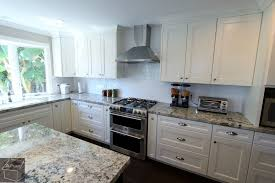 Contemporary U Shaped Kitchen Remodel With White Custom Cabinets