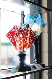 3 dimensional pieces like dishes and lamps are then placed in a second kiln firing over or into a mold this is what gives the glass its form