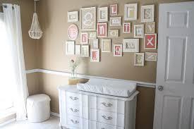 neutral nursery design with pops of color! love the framed alphabet.