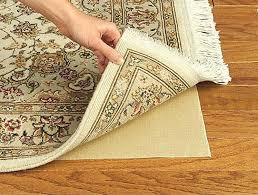 rug pads for wood floors rug pads for hardwood floors living room transitional with area rug