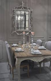 charming shabby chic dining room in french grey with an excuisite carved french