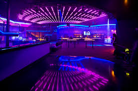 this colourful nightclub uses led light strips to create an interior nightclub design