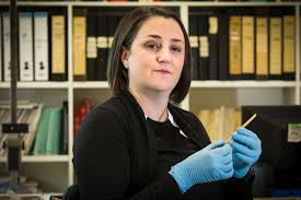 Dr Michelle Langley holds Australia's oldest known bone tool - ABC ...