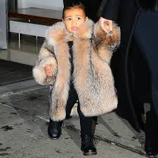 kim north west spotted both wearing big fur coats photos