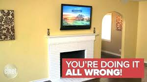 hanging television over fireplace television above gas