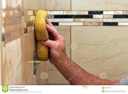 Grouting wall tile Subway Tile Hand Applying Grout To Wall Tiles Dreamstimecom Hand Applying Grout To Wall Tiles Stock Image Image Of Work