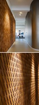 by using natural wood shingles in this way it has helped to create a contemporary office space that feels warm and inviting