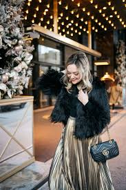 jessica rose sy wearing a black and gold holiday outfit 1 state black faux