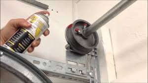 squeaky garage doorDAYTONA BEACH GARAGE DOOR REPAIR  How to lube your Garage Door