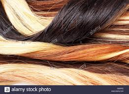 blond red and black real women human hair extension weft close up photo real european