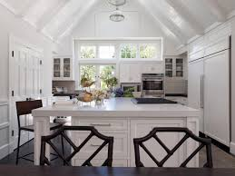 small minimalist and high vaulted ceiling kitchen design with all white cabinet interior color decor plus haning lamp above island ideas