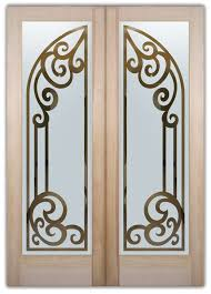 double entry doors etched glass iron bars ornate flourishes tuscan design sans soucie concorde arched