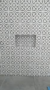 bathrooms feature walls with 20x20cm cement patterned tiles